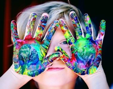 Boy with paint on his hands.