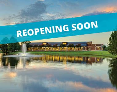 A photo of the Cozby Library with a blue banner across the image. Text reads &#34Reopening Soon&#34