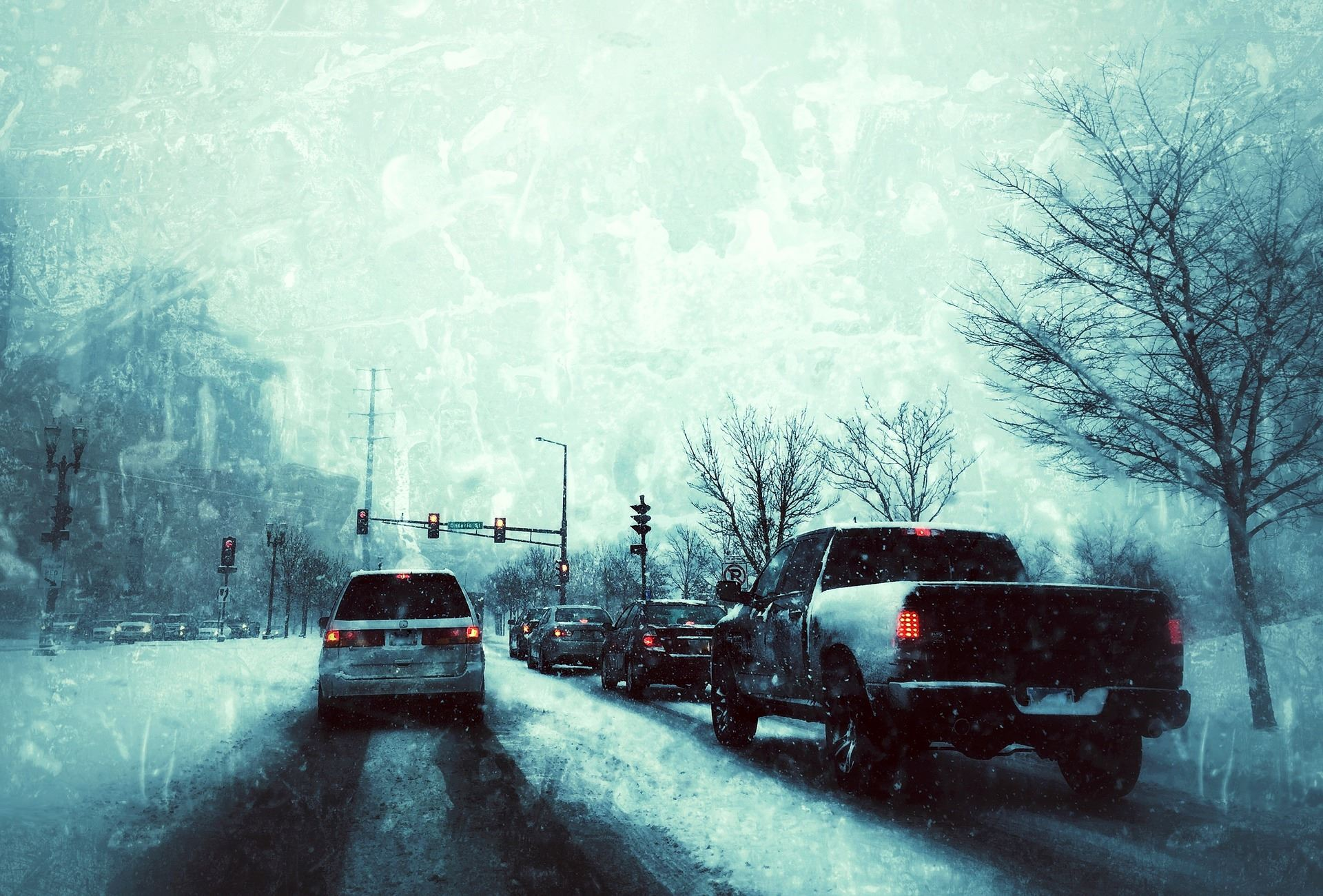View of Winter Traffic through a Windshield